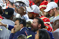 2nd February 2020, Miami Gardens, Florida, USA;   Kansas City Chiefs Defensive Tackle Mike Pennel (64) kisses  the Vince Lombardi Trophy on the podium after Super Bowl LIV on February 2, 2020 at Hard Rock Stadium in Miami Gardens