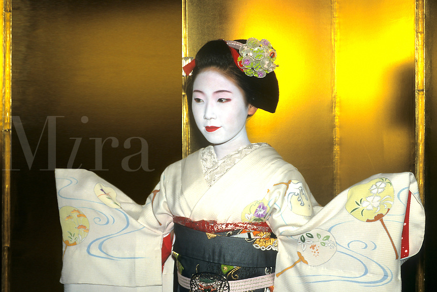 Geisha Girl in gold , Kyota, Japan