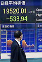 A man looks at a stock market indicator board on April 30, 2015, Tokyo, Japan. The Japanese Nikkei index ended 0.83% (538.94 points ) lower at 19,520.01 on Thursday. This is the biggest drop in four moths after briefly crossing the 20,000 Yen line for the first time since April 2000. Asian markets traded lower pulled down by weak U.S. growth figures for the first three months of 2015. (Photo by Rodrigo Reyes Marin/AFLO)