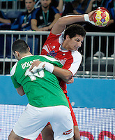 Algeria's Saci Boultif (l) and Egypt's Ali Zein during 23rd Men's Handball World Championship preliminary round match.January 15,2013. (ALTERPHOTOS/Acero) /NortePhoto