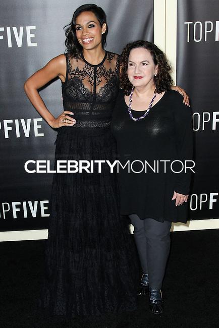 NEW YORK CITY, NY, USA - DECEMBER 03: Rosario Dawson, Olga Merediz arrive at the New York Premiere Of 'Top Five' held at the Ziegfeld Theatre on December 3, 2014 in New York City, New York, United States. (Photo by Celebrity Monitor)