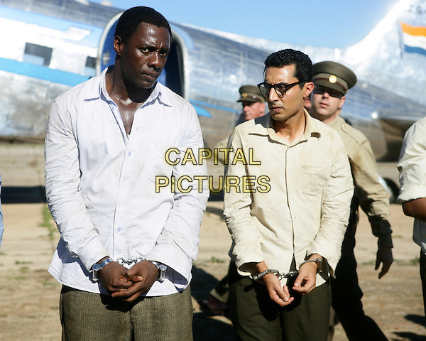 Idris Elba, Riaad Moosa<br /> in Mandela: Long Walk to Freedom (2013) <br /> *Filmstill - Editorial Use Only*<br /> CAP/FB<br /> Image supplied by Capital Pictures