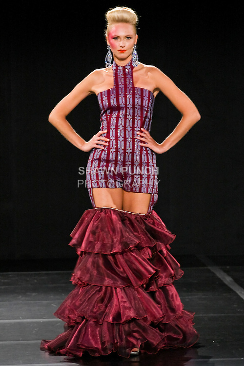 Model walks the runway in an outfit by  Zizi Cardow for the Zizi Cardow Spring 2011 fashion show, during Couture Fashion Week, September 11, 2010.