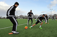 SWANSEA, WALES - JANUARY 28: (L-R) Ki Sung Yueng, Gylfi Sigurdsson and Jack Cork in action during the Swansea City Training Session on January 28, 2016 in Swansea, Wales.