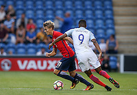 Martin Odegaard (Real Madrid) of Norway moves away from Marcus Rashford (Manchester United) of England during the International EURO U21 QUALIFYING - GROUP 9 match between England U21 and Norway U21 at the Weston Homes Community Stadium, Colchester, England on 6 September 2016. Photo by Andy Rowland / PRiME Media Images.