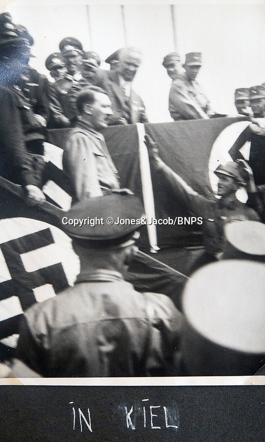 BNPS.co.uk (01202 558833)<br /> Pic: Jones&Jacob/BNPS<br /> <br /> Hitler at a Nazi rally in Kiel.<br /> <br /> Springtime for Hitler...Chilling album of pictures taken by one of Hitlers bodyguards illustrates the Nazi dictators rise to power.<br /> <br /> An unseen album of photographs taken by a member of Hitlers own elite SS bodyguard division in the years leading up to the start of WW2.<br /> <br /> The 1st SS Panzer Division 'Leibstandarte SS Adolf Hitler' or LSSAH began as Adolf Hitler's personal bodyguard in the 1920's responsible for guarding the Führer's 'person, offices, and residences'.