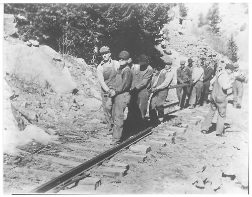 Workers removing C&amp;S tracks.<br /> C&amp;S    ca. 1938