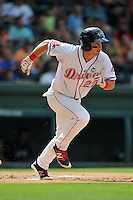 Designated hitter Mitchell Gunsolus (22) of the Greenville Drive runs out a grounder in a game against the Hagerstown Suns on Sunday, July 17, 2016, at Fluor Field at the West End in Greenville, South Carolina. (Tom Priddy/Four Seam Images)