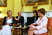 Laura Bush talks with Viktorie Spidlova, wife of the Prime Minister of the Czech Republic Vladimir Spidla, during a coffee hosted in her honor in the Yellow Oval Room of the White House in Washington, DC on Tuesday, July 15, 2003. <br /> Mandatory Credit: Susan Sterner / White House via CNP