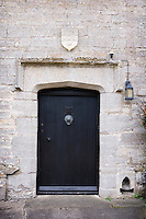 The black-painted front door of Ellys Manor House, a unique Tudor wool merchant's house