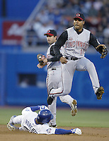 Barry Larkin of the Cincinnati Reds throws to first base after forcing out Dave Roberts of the Los Angeles Dodgers at second base during a 2002 MLB season game at Dodger Stadium, in Los Angeles, California. (Larry Goren/Four Seam Images)