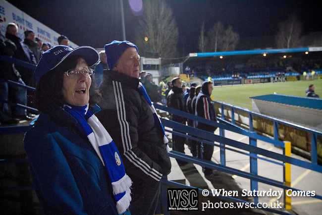 Macclesfield Town 0 Gateshead 4, 22/02/2013. Moss Rose, Football Conference. A woman in a blue baseball hat watching the early action as Macclesfield Town (in blue) host Gateshead at Moss Rose in a Conference National fixture. The visitors from the North East who were in the relegation zone, shocked Macclesfield with four first half goals and won 4-0 in front of 1467 fans. Both teams were former members of the Football league, with Macclesfield dropping out in 2012. Photo by Colin McPherson.