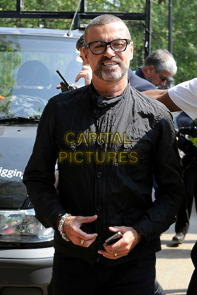 GEORGE MICHEAL.Arriving for filming for the Royal Wedding of Prince William & Catherine(Kate) Middleton, London, England.  .April 28th, 2011.half length black shirt sunglasses shades beard facial hair .CAP/IA.©Ian Allis/Capital Pictures.