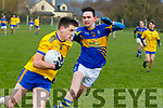 Dan Shea, Ballymac, tries to escape from Alan Murphy, Glenflesk  during the Senior Football League, Division 2, Round 1 game played at Ballymac GAA ground last Sunday.