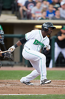 Taylor Trammell (5) of the Dayton Dragons follows through on his swing against the West Michigan Whitecaps at Fifth Third Field on May 29, 2017 in Dayton, Ohio.  The Dragons defeated the Whitecaps 4-2.  (Brian Westerholt/Four Seam Images)