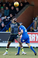 Barry Fuller of AFC Wimbledon and Ellis Harrison of Bristol Rovers during the Sky Bet League 1 match between AFC Wimbledon and Bristol Rovers at the Cherry Red Records Stadium, Kingston, England on 17 February 2018. Photo by Carlton Myrie.