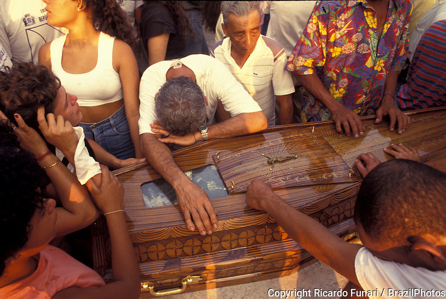 Funeral of victims of a slaughtering of workers in a shantytown by policemen. Rio de Janeiro, Brazil. Violence, human rights violation, suffering, black people, burial, coffin, pain, grief, sorrowful.