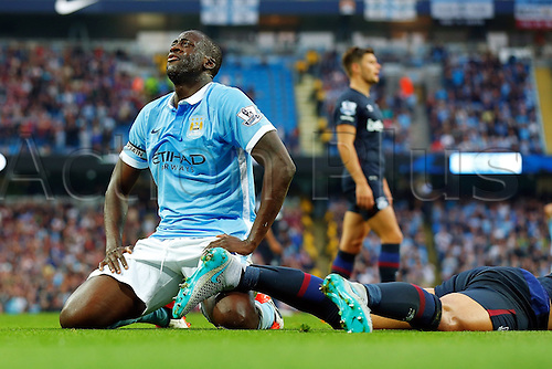 19.09.2015. Manchester, England. Barclays Premier League. Manchester City versus West Ham. Yaya Toure of Manchester City closes his eyes and kneels after his shot at goal misses the target as Man City piles pressure on the West Ham defense int he second half