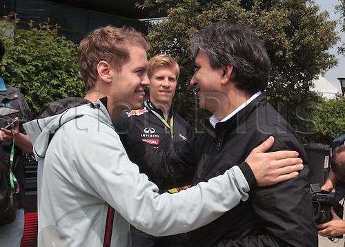 12.04.2012. Shanghai, China. Formula 1 Grand Prix of China.  Sebastian Vettel and Heikki Huovinen, Red Bull Racing greet Pasquale Lattuneddu, FOM, ..