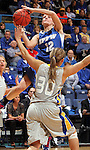 SIOUX FALLS, SD - MARCH 11:  Erin Murphy #12 from IPFW takes the ball to the basket against Ashley Eide #30 from South Dakota State in the second half of their semifinal game Monday afternoon at the 2013 Summit League Tournament in Sioux Falls, SD.  (Photo by Dave Eggen/Inertia)