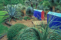 Peckerwood Garden Texas- painted walls and gravel path in cactus hardy succulent garden