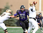 SIOUX FALLS, SD - OCTOBER 18: Marco Naughton #94 from the University of Sioux Falls gets a step past Austin Hilgert #70 from Southwest Minnesota State en route to quarterback Charlie Kern #7 in the second half of their game Saturday afternoon at Bob Young Field in Sioux Falls. (Photo by Dave Eggen/Inertia)
