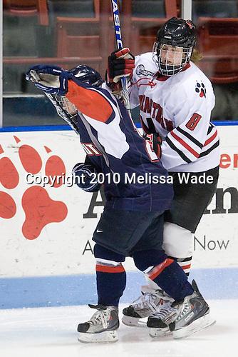 Kelly Horan (UConn - 21), Alyssa Wohlfeiler (NU - 8) - The University of Connecticut Huskies defeated the Northeastern University Huskies 4-1 in Hockey East quarterfinal play on Saturday, February 27, 2010, at Matthews Arena in Boston, Massachusetts.