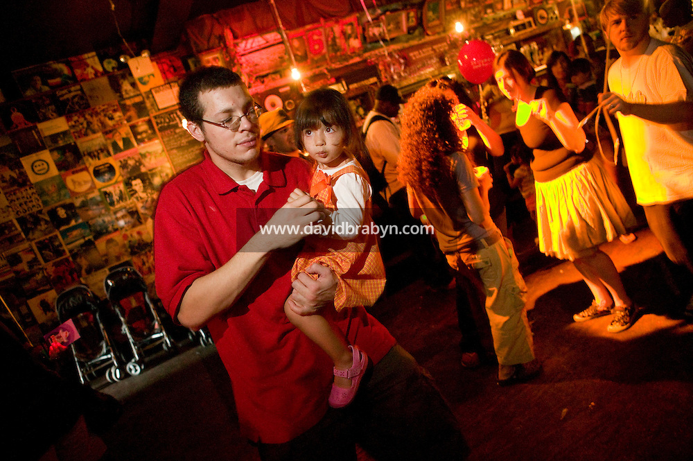 Parents and babies attend a Baby Loves Disco event at Southpaw nightclub in the Park Slope neighborhood of Brooklyn in New York City, USA, 6 October 2007. In two years, Baby Loves Disco, a midday soiree specifically for the Mommy-and-me set, has become a nationwide phenomenon. One afternoon each month, local organizers take over a nightclub, complete with a cash bar and DJ and throw open the doors to anyone under the age of 7, accompanied by parents.