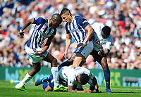 Tottenham Hotspur's Danny Rose is tackled by West Bromwich Albion's Allan-Romeo Nyom and Jake Livermore<br /> <br /> Photographer Ashley Crowden/CameraSport<br /> <br /> The Premier League - West Bromwich Albion v Tottenham Hotspur - Saturday 5th May 2018 - The Hawthorns - West Bromwich<br /> <br /> World Copyright &copy; 2018 CameraSport. All rights reserved. 43 Linden Ave. Countesthorpe. Leicester. England. LE8 5PG - Tel: +44 (0) 116 277 4147 - admin@camerasport.com - www.camerasport.com