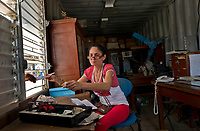 SAN ANTONIO DE LOS BANOS, CUBA - FEBRUARY 8: A Cuban woman sells tickets at the train station of San Antonio de los Baños on February 8, 2018 in Cuba. Ferrocarriles de Cuba, is one of the oldest railroad around world, having opened its first route in 1837 with at least 17-mile long. Now the railway probably could cover more than 2,600 miles along the Island. (Photo by Eliana Aponte/VIEWpress)