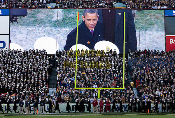 United States President Barack Obama, as seen on a large video screen greets navy midshpmen as he arrives on the field at the 112th Army vs. Navy Football game at FedEx Field in Landover, Maryland, USA..December 10th, 2011.atmosphere gv general view goal posts crowd tv.CAP/ADM/KT.©Kristoffer Tripplaar/Pool/CNP/AdMedia/Capital Pictures.