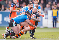 Picture by Allan McKenzie/SWpix.com - 11/03/2018 - Rugby League - Betfred Super League - Castleford Tigers v Salford Red Devils - the Mend A Hose Jungle, Castleford, England - Castleford's Nathan Massey is tackled by Salford's Tyrone McCarthy &. Luke Burgess.