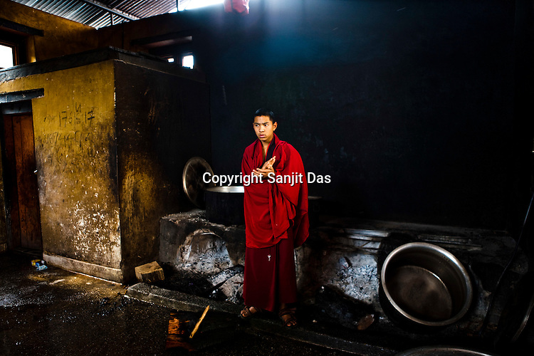 A Buddhist monks is seen inside the kitchen of the ancient Punakha Dzong (fortress) in Punakha, Bhutan. Phunakha was the capital of Bhutan and the seat of government until 1955, when the capital was moved to Thimphu. Punakha is the administrative centre of Punakha dzongkhag, one of the 20 districts of Bhutan. Photo: Sanjit Das/Panos