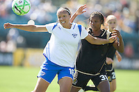 Angela Hucles shields the ball from Formiga (31). FC Gold Pride defeated the Boston Breakers 2-1 at Buck Shaw Stadium in Santa Clara, California on April 5th, 2009.