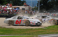 Aug. 8, 2009; Watkins Glen, NY, USA; NASCAR Nationwide Series driver Matthew Carter (61) and Robby Gordon (55) spin off course during the Zippo 200 at Watkins Glen International. Mandatory Credit: Mark J. Rebilas-