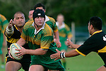 R. Johnson looks for support as the Bombay tacklers close in. Counties Manukau Premier Club Rugby, Drury vs Bombay played at the Drury Domain, on the 14th of April 2006. Bombay won 34 - 13.
