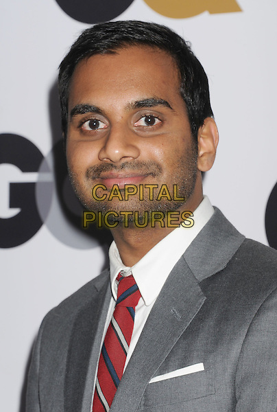 Aziz Ansari.Arriving at the GQ Men Of The Year Party at Chateau Marmont Hotel in Los Angeles, California, USA..November 13th, 2012.headshot portrait shirt red tie grey gray suit stubble facial hair white  .CAP/ROT/TM.©Tony Michaels/Roth Stock/Capital Pictures