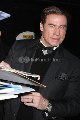 NEW YORK, NY - FEBRUARY 2:  John Travolta signs autographs for fans outside of 'Good Morning America'  where he promoted the TV mini-series 'American Crime Story: The People vs. O.J. Simpson' in New York, New York on February 2, 2016. Photo Credit: Rainmaker Photo/MediaPunch
