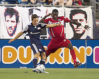 New England Revolution midfielder Ryan Guy (13) crosses the ball as Chicago Fire defender Jalil Anibaba (6) defends. In a Major League Soccer (MLS) match, the New England Revolution tied the Chicago Fire, 1-1, at Gillette Stadium on June 18, 2011.