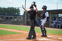 Umpire Alex Lawrie and catcher Hemmanuel Rosario (7) during a Gulf Coast League game between the GCL Phillies East and GCL Yankees East on July 31, 2019 at Yankees Minor League Complex in Tampa, Florida.  (Mike Janes/Four Seam Images)