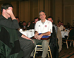"Jon Stewart, host of Comedy Central's ""The Daily Show"" holds the plaque declaring him to the NSCAAs Honorary All-America Team for 2005 as he listens to another speaker on Saturday, January 21st, 2006, during the National Soccer Coaches Association of America's annual convention in the Grand Ballroom of the Pennsylvania Convention Center in Philadelphia, PA."