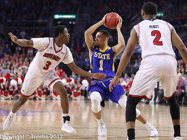 SIOUX FALLS, SD: MARCH 6: Skyler Flatten #1 of South Dakota State drives between South Dakota defenders Triston Simpson #3 and Carlton Hurst #2 during the Summit League Basketball Championship on March 6, 2017 at the Denny Sanford Premier Center in Sioux Falls, SD. (Photo by Dick Carlson/Inertia)