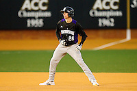 Jack Havey #26 of the Northwestern Wildcats takes his lead off of second base against the Wake Forest Demon Deacons at Gene Hooks Field on February 26, 2011 in Winston-Salem, North Carolina.  Photo by Brian Westerholt / Four Seam Images
