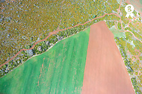 Dirt road by plowed fields at spring, aerial view (Licence this image exclusively with Getty: http://www.gettyimages.com/detail/101682983 )