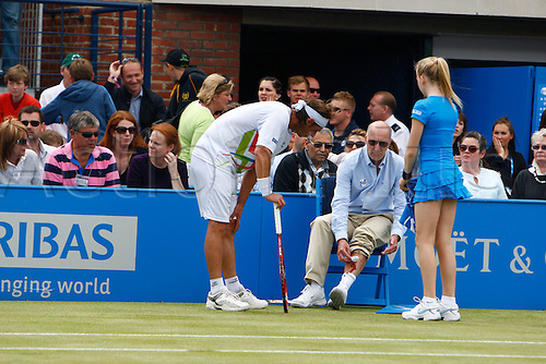 17.06.12 Queens Club, London, ENGLAND: David Nalbandian ARG hurts the line judge mens singles final round match during Marin Cilic CRO versus David Nalbandian ARG on day Seven of the Aegon Championships at Queens Club ..on June 17, 2012 in London , England.Nalbandian was disqualified from the Championships final after injuring the line judge by kicking an advertising board onto his shin.