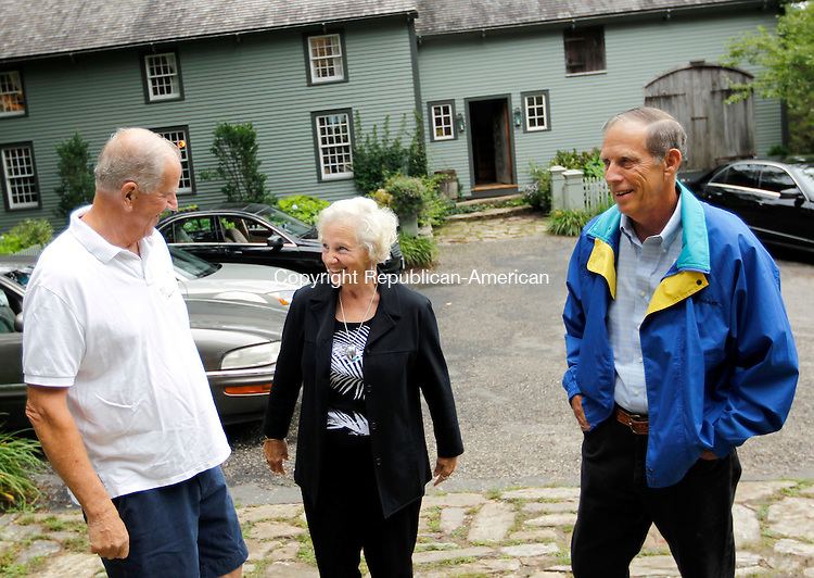 "Woodbury, CT-20 July 2012-072012CM02-  Bill Drakeley (left) greets Sandy and Ken Green of Woodbury, Friday night at Drakeley's home in Woodbury.  Bill along with his wife, Joyce, hosted their annual Neighbors Helping Neighbors charity event, which benefits the Community Services Council of Woodbury, a organization that helps others ""restore their financial security through access to food, fuel and crisis assistance.""   Joyce Drakley said 100% of the donations go directly to the Community Services Council, which also includes donations from various auction items.  She added the event wouldn't have been possible without the help of her volunteers.   Christopher Massa Republican-American"