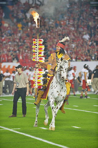 MIAMI GARDENS, FL - JANUARY 01: Chief Osceola of the Florida State Seminoles rides Renegade onto the field prior to the game against the Northern Illinois Huskies during the 2013 Discover Orange Bowl at Sun Life Stadium on January 1, 2013 in Miami, Florida. The Seminoles defeated the Huskies 31-10. The Seminoles defeated the Huskies 31-10.  © MPI10/MediaPunch Inc