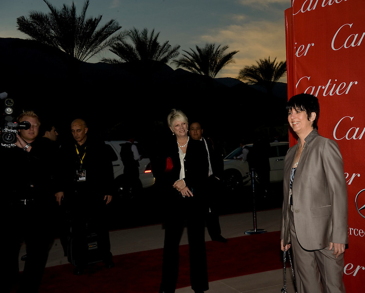 Diane Warren, right, smiles for the cameras prior to receiving the Frederick Loewe Music Award during the Palm Springs International Film Festival awards gala at the Palm Springs Convention Center on Saturday.