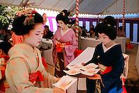 Geishas (Maiko & Geiko) serving during Nishijin Yumematsuri (Festival), Kitano-Tenmangu Shrine, Kyoto, Japan