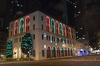 The HECO (Hawaiian Electric Company) building decorated with Christmas lights in downtown Honolulu, O'ahu.